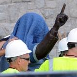 Image: Penn State workers cover the Joe Paterno statue near Beaver Stadium